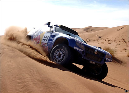 Ari Vatanen's VW Touareg crests a dune during the fourth stage between Er-Rachidia and Ouarzazate in Morocco