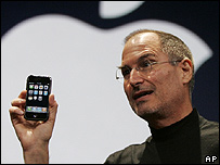 Apple boss Steve jobs with an iPhone
