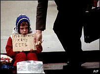A homeless child begs in Moscow (image from 1994)