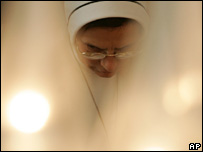 Nun praying, AP