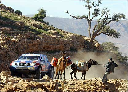 The Mitsubishi of Frenchmen Benoit Rousselot and Gilles Mondesir encounter a farmer and his mules during stage three in Morocco
