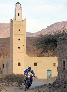 Spain's Isidre Eseve Pujol passes a mosque during Wednesday's fifth stage between Ouarzazate and Tan Tan in Morocco