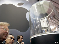 An onlooker admires Apple's new device