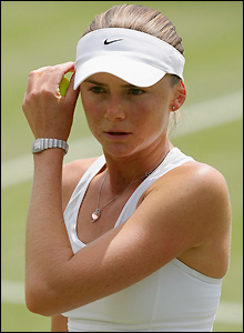 Daniela Hantuchova readjusts her headwear between points