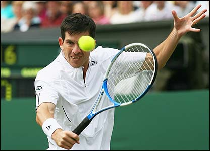 Tim Henman makes a volley