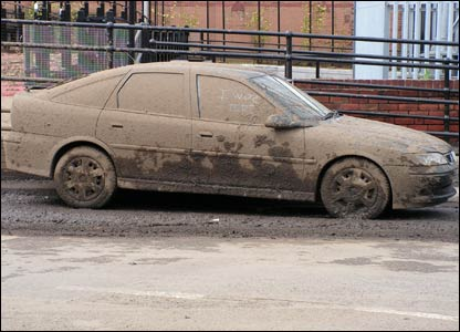 A car covered in mud.  Picture: Jonathan Golomb