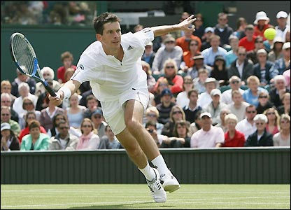 Henman stretches for a shot