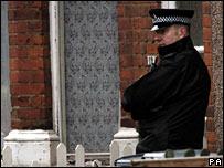 Police officer outside the address in Nelson Street
