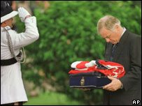 Chris Patten holds the folded British flag upon leaving Government House in Hong Kong on 30 June 1997