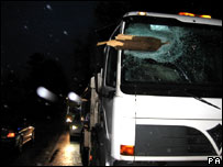 Police handout picture of a lorry hit by a plank blown from a vehicle travelling along Spread Eagle Hill, in Dorset.