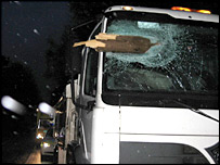 Plank embedded in cab of lorry in Dorset, leaving driver with head injuries, picture from Dorset Police