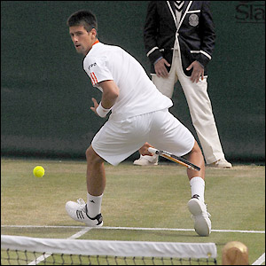 Djokovic plays a cheeky shot through his legs
