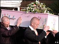 Kiel Simpson (right) and others carry Ellie Lawrenson's coffin