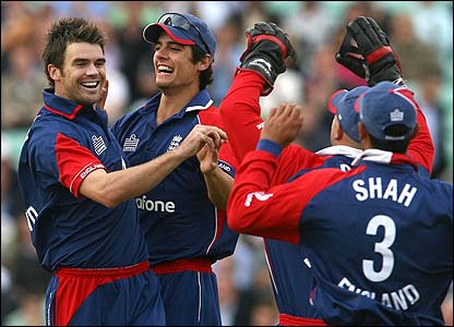 James Anderson is congratulated by his England team-mates