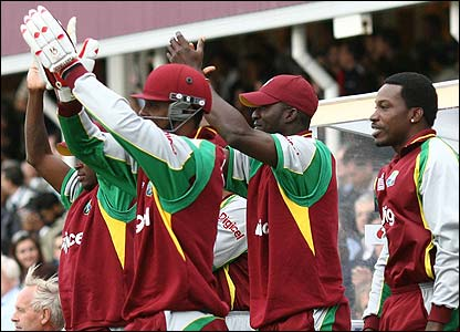 West Indies players cheer from the bench