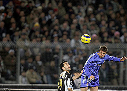 David Beckham competes for the ball against Juventus