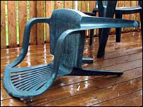 A plastic chair blown over by the wind