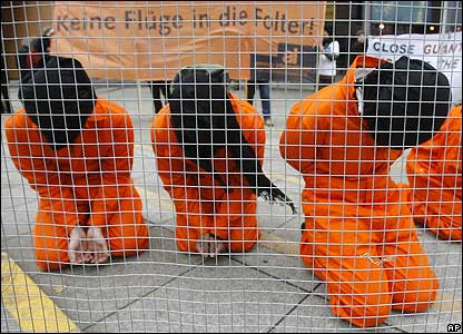 "German human rights activists protest in Berlin (Sign reads: ""No flights into torture"")"