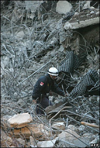 A policeman surveys damaged after the bomb blast at Barajas airport