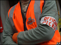 A Royal Mail worker on strike at a north London sorting office