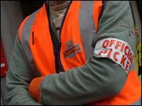 A Royal Mail worker on strike in a north London sorting office