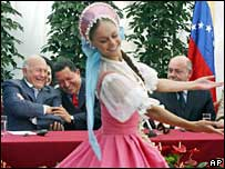 Hugo Chavez shares a joke with Moscow Mayor Yuri Luzhkov during the opening of a Venezuelan culture centre