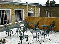 Tables and chairs on a roof terrace