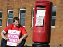 A postal worker on the picket line in Scotland