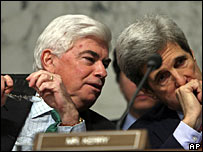 Senator Chris Dodd speaks to Senator John Kerry