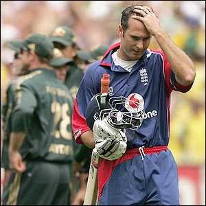 Michael Vaughan trudges off after being dismissed by Nathan Bracken