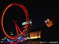 Man taking image of London Eye