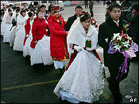 Couples prepare to get married at a mass wedding in Harbin, China, on 8 January 2007