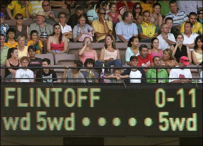 The scoreboard shows 11 extras from Flintoff's opening over