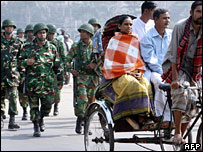 Troops and people in Dhaka a day after the imposition of emergency