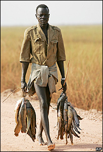 Man carrying a fish (Image: AP)