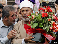 Sheikh Hilali with flowers outside his mosque in Sydney in November 2006