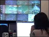 A woman looks at a computer screen at Italian transport agency Atac