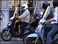 Moped drivers stuck in traffic in Rome