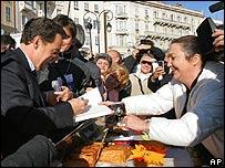 Nicolas Sarkozy is asked to sign a book