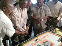 ANC officials cutting a birthday cake