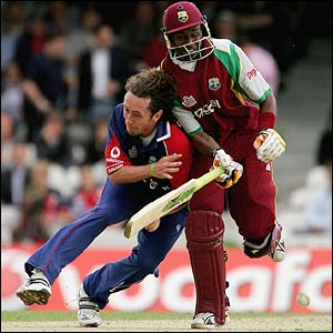 England's Ryan Sidebotom collides with Dwayne Bravo
