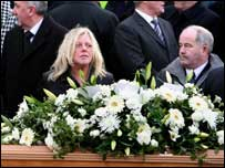 Mr Ervine's wife Jeanette at the coffin of her husband