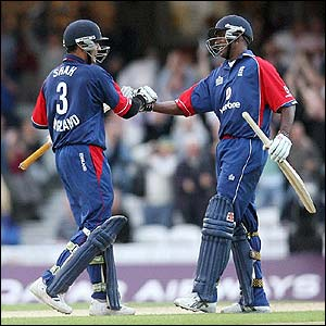 Owais Shah celebrates with England team-mate Dimitri Mascarenhas