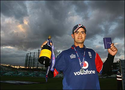 Owais Shah poses with champagne and his man of the match award