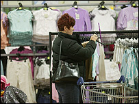A customer browses Tesco's clothing