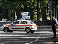 A police officer and squad car near Hyde Park, London