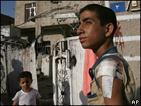 Injured Iraqi boy in front of house in Sadr City, 30 June 2007