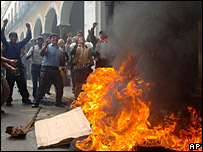 Protesters burn tyres in front a city building in Cochabamba, Bolivia