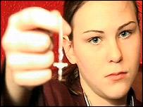 Samantha Devine holding her crucifix