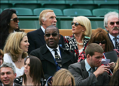 Bruce Forsyth, back row centre, Lenny Henry, centre, Des Lynam, right, Dawn French, second right and Sally Phillips, middle left, sit in the royal box on Centre Court